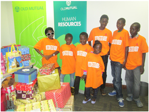 The children from the Orange Babies Foundation are delighted with the shoeboxes they received from Old Mutual. Judging from their smiles they could not wait to open them. (Photograph by Mandisa Rasmeni)