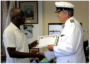 The chief of the Namibian Defence Force, Lieutenant General ED Ndaitwah (left) presents Captain Rainer Kümpel with his accreditation certificate as German Defence Attache to Namibia.