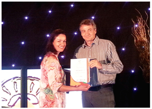 Hazel Milne, the programme coordinator of the Eco Awards, presents an award to Gondwana's managing director, Mannfred Goldbeck.