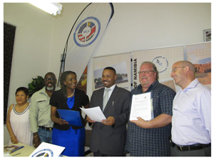 Celebrating the funding agreement for tour guide training are from left to right: Jean Averia (NATH CEO), Axaro Thaniseb (NHC Vice Chairperson), Tuli Nghiyoonanye (MCA-N Education Director), Rev. Salomon April (NHC Director), Larry Laursen (NATH Board Secretary), and Martin Wilkinson (MCA-N Skills Development Manager)