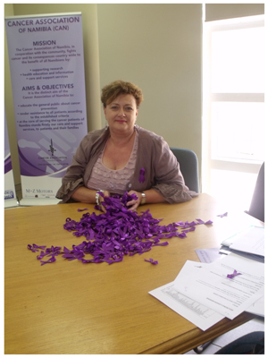 Ms Reinette Koegelenberg, Chief Executive Officer of the Cancer Association with purple cancer ribbons that represents all types of cancer.