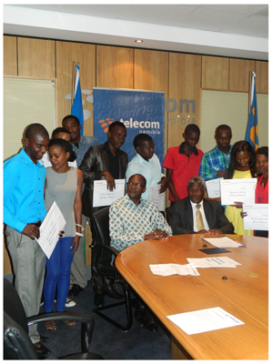 Telecom Namibia handed over bursaries to deserving students, to further their studies at their preferred institutions. Seated from left to right Minister of Education, Dr Namwandi, Managing Director of Telecom Namibia, Mr Frans Ndoroma, at the back are the recipients of the bursaries. (Picture by Mandisa Rasmeni)