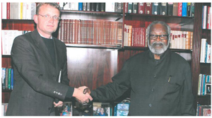 Hans-Wilhelm Schütte (left), Managing Director of Ohrongo Cement, with former President, Dr Sam Nujoma, finalising the deal to support the building of the Etunda Primary School and Clinic. Current planning makes provision for further development and expansion. Etunda is the founding father's farm on the B1 road between Otavi and Otjiwarongo.