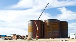 Construction of B2Gold's Otjikoto gold mine is steadily nearing completion with four giant tanks recently fitted to aid mining operations.