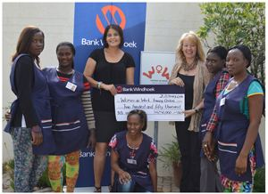 Rochelle Innes (left), Head: Business Intelligence at Bank Windhoek and Leonie Lubbe (right), General Manager of the Woman at Work Training Centre, celebrating the news of the substantial sponsorship with their students.