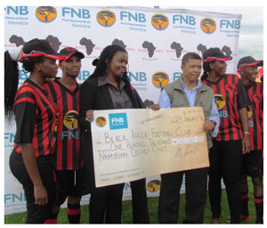 FNB's Ester Kali and Cassius Moetie with a score of BA supporters and fans.