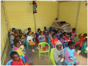 Children from the Maria Kindergarten enjoying juice and snacks that MTC employees handed out to them as part of their response to the neknomination challenge they got from the Trustco Group (Photograph by Mandisa Rasmeni)