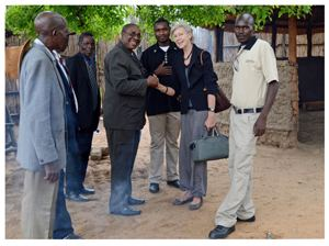 Governor of the Zambezi region, the Honourable Lawrence Sampofu, shaking hands with Antje Otto who assembled the interesting information displayed at the Centre.