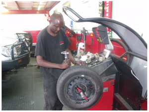 Safety conscious Moses Medusalem shows how a punctured tyre is fixed, the Tiger Wheel and Tyre way