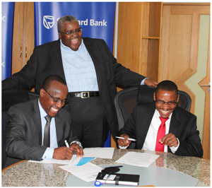 Standard Bank Namibia signed the Wages and Benefits Agreement with the Bank Workers Union of Namibia (BAWON) putting into effect an 8% increase for the bank's employees effective 01 March 2014. Sealing the agreement are Isdor Angula, Standard Bank's Head of Human Resources, Mpumzi Pupuma, Standard Bank CEO, and Thomas Muchima, Secretary General of the bank union.
