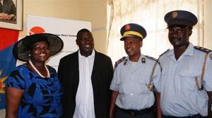 Safety and Security Permanent Secretary, Dr Ndeutala Angolo and the Mayor of Otavi, Markus Damaseb with Deputy Commissioner Mavenjono and Inspector Shipepe of the Otavi Police Station when the latter received a fax machine from Ohorongo Cement.