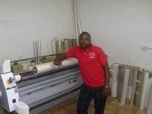Chief Laminator at Plastic Print, Albert Ndala (Photograph by Musa Carter)