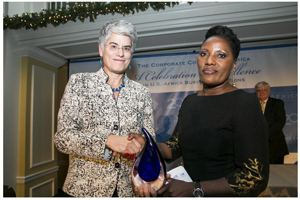 Businesswoman on the international radar. United Africa Group Chairman, Martha Namundjebo-Tilahun (right) receiving her African Business Leaders of the Year Award from Diane Willkens, Founder and President of Development Finance International Inc.
