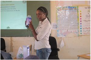 Angelina Kanduvarisa, a researcher at Agra ProVision, demonstrates how to administer specialised veterinary medicine.