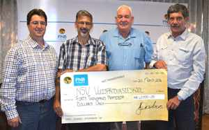 Generous contribution from Christo Viljoen: Head FNB Agri and Tourism (left), Jacque Els: Manager Namibian Stud Breeders Association, Dawid Krause: Feedmaster, and Ryno van der Merwe: Chairman of Namibian Stud Breeders Association Board