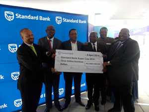 The N$3-million boost. Handing over the sponsorship are Chief Executive of Standard Bank: Junius Mungunda, Head of Marketing, Standard Bank: Thaddius Maswahu, Director of Sport: Benhard Kaanjuka, Vice President of NFA: Kornelius Kapenda Secretary General of NFA: Barry Rukoro and former Chief Executive of Standard Bank: Mpumzi Pupuma.(Photograph by Musa Carter)