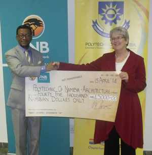 "Caption: Prof Tjama Tjivikua, Rector of The Polytechnic of Namibia (Left), and Mrs Jane Katjavivi, Chairperson of FNB Namibia, with the N$45,000 cheque sponsorship for the book production of the architectural exhibition ""The Legacies of a Colonial Town"", by the Architecture and Spatial Science Department of the Polytechnic of Namibia. (Photograph by Mandisa Rasmeni)"