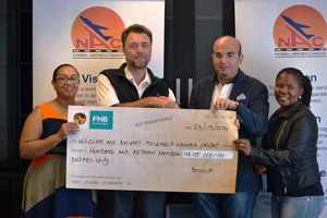 Mia Davids, Head: Corporate Communications, NAC, Dr Petter Tarr, Environment Scientist, Tamer El-Kallawi Acting CEO, NAC and Veronica Montsi, Corporate Social Responsibility Member, NAC - with the N$115 000 cheque donated to The Wildlife and Aircraft Research Namibia Project by NAC