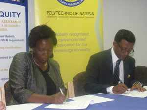 The Polytechnic of Namibia and the Namibia Students Financial Assistance Fund (NSFAF) signed a Memorandum of Understanding (MoU) on 22 April 2014, indicating that both these organisations have structured their systems to make it easier for government to release funding to the point where the students can access the funds for their studies. (L-R) Mrs Hilya Nghiwete, CEO of the NSFAF, and Prof Tjama Tjivikua signing the MoU (Photograph by Mandisa Rasmeni)