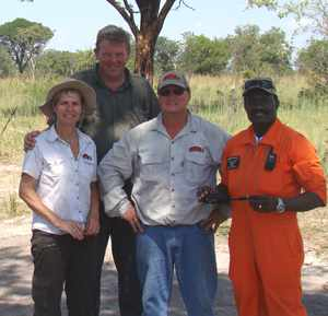 Driving force behind the Cowboy's team, Heinz (Cowboy) Büttner (second from left) with site clearing partner Jan Vader of BCG Aircraft Recoveries (back), project coordinator, his wife Ulla (left), and the Director of the Namibian Aircraft Accident Investigation Division, Capt. Ericksson Nengola (right).