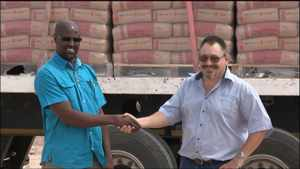 Deputy Mayor of Outjo, Mr Fransley Gordon /Gomseb (left) receiving the load of cement from Rudolf Coetzee, Administration Manager of Ohorongo Cement