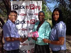 From left to right: Pick 'n Pay Managing Director, Henry Feris; Oshakati Life Change Centre's Rebekka Shilongo and Pick n Pay Oshakati Store Manager, Hester Uushona at the handover of a Pick 'n Pay shopping voucher to the Oshakati Life Change Centre