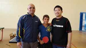 13-year old Marnus Garbers sold his Play Station to buy his own table tennis board. Here he is with South African professional player, Shane Obermeyer and Western Province coach, Chiang Lin.