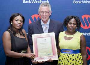 Bank Windhoek Rundu branch won the Gold Award in the Best Brand Ambassadors Team category at the Bank Windhoek Brand Ambassadors Gala Awards ceremony held in April. Receiving the award from Christo de Vries, Managing Director of Bank Windhoek, are Sheida Thikusho (left) and Regina Khaebes (right) of the Rundu branch.
