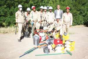 Sylvanie Beukes with the group of miners and the equipment they received from Geo-Capricon and the Social Security Commission Development Fund.