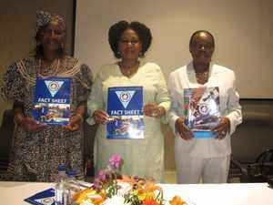 Presenting the MCA-N Project Fact Sheet on Khomas Region and the MCA-N Annual Report 2013 from left to right: Katutura East Councillor Alina Ndapuka, Khomas Governor Laura McLeod-Katjirua and MCA-N CEO Penny Akwenye.