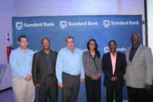 Standard Bank officials announcing the Auto Show are, from left to right, Eugene Junius, Vehicle and Asset Finance New Business Manager, Junius Mungunda, Chief Executive Officer, Wim Lötter, Head of Vehicle and Asset Finance, Baronice Hans, Head Personal and Business Banking, Isador Angula, Head of HR and Ehrenfried Merero, Head Risk & Legal and Compliance. The launch was held at the Old Wheelers Club in Olympia. (Photograph by Mandisa Rasmeni)
