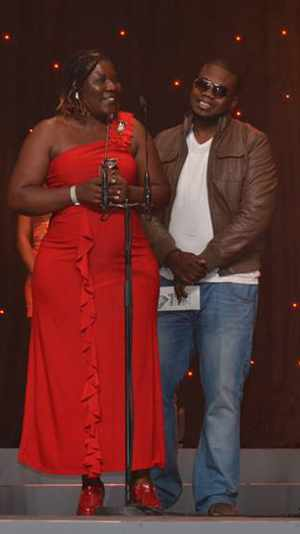 Erna Chimu (in red dress) receiving one of her three awards at the NAMAs 2014