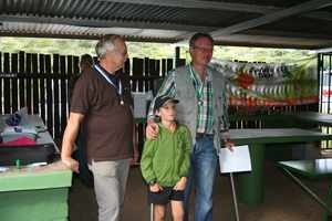 From left to right: Dr Rainer Hassel, Zander Burger the youngest participant receiving his prize from Dr Jürgen Hoffmann at the most recent Clay Target competition