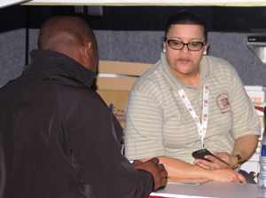 Ms. Cecilia Scheepers: Supervisor Customer Services assisting a prospective Social Security member at the Okahandja expo.
