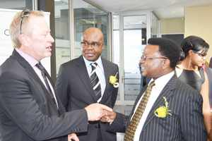 On the 10th anniversary of the Development Bank of Namibia, Founding Chairperson Sven Thieme (left) and Founding CEO David Nuyoma (right) met again as incumbent DBN CEO Martin Inkumbi enjoys the moment.