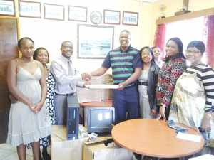 People's Primary School – Handing over the PCs are Standard Bank Katutura Branch Manager Lasarus Shikongo to PSS Principal Mr Xoagub