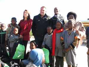 Dr Christina Swart-Opperman (back, left) with the MD of Namibia Breweries Ltd, Mr Wessie van der Westhuizen, and Olof Palme Primary principal, Mrs Julia Hangula (right). The group of learners are from Olof Palme Primary School, a regular beneficiary of CSO Aids Orphan Foundation projects.