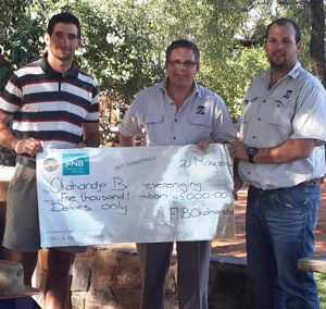 From the left, Andrew Campbell of the Okahandja Farmers Association, Henk Steyn, Branch Manager, FNB Okahandja and Gerrit Barnard, also of the Okahandja branch.