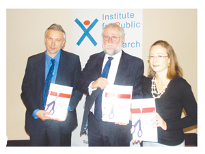 Cut the red tape. From left to right: Institute for Public Policy Research Executive Director Graham Hopwood; Minister of Trade and Industry Calle Schlettwein, and British High Commissioner to Namibia, Marianne Young. (Photograph by Freeman Ngulu)