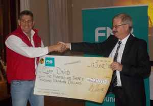 Jacques van Vuuren (left) of Camp David accepting the sponsorship from Dixon Norval, a trustee of the FNB Namibia Foundation at the launch of the Hallelujah Namibia Festival earlier this week. (Photograph by Mandisa Rasmeni)