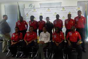 Rosalia Martins-Hausiku, MVA Fund CEO (centre front), Brandon Diergaardt (centre back), with the ten future paramedics who received bursaries form the MVA Fund. (Photograph by Mandisa Rasmeni)