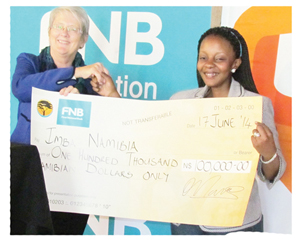 Jane Katjavivi, Chairperson of the FNB Foundation presenting the cheque to Lydia Ramphoma.