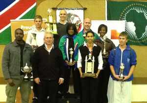 The Goju trophy winners are from the left, Sam Ekandjo, 20 years training; Brown Belt Grand Champion: Shaun Halgreen; Sensei Carl van der Merwe, 30 years training; Black Belt Male Grand Champion: Jürgen Van Wyk; Best Sport Performance Girls: Riona Pillay; Best Sport Performance Male Under Brown Belt: Thomas Mechnig; Black Belt Female Grand Champion: Shirleen De Wee; Special Award for Achievements at the World Goju-Ryu Karate Federation Championships: Phortune Tjivikua; and Best Sport Performance Boys: Reino Hansen.