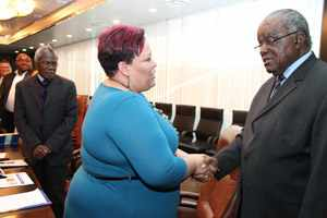 President Hifikepunye Pohamba (right) greets Chairperson of the Telecom Namibia Board of Director Dr Catherine Beukes-Amiss during the company's courtesy call on State House