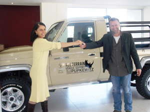 Rhino Tough: Pupkewitz Foundation Chairperson Meryl Barry hands over keys to the all terrain vehicle  to Legal Assistance Centre's Willem Odendaal, Coodinator for the Land Environment  and Development Project in the Palmwag Concession Area