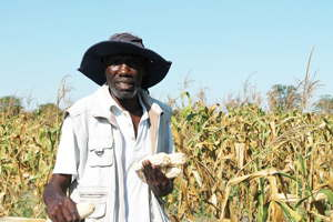 Master farmer, Lennox Kulobone of Sibbinda in Linyanti Constituency one of the three finalists holding his produce