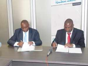 (L-R) Mr Phillip Shiimi, CEO of NAMFISA and Mr Mihe GaomabII, CEO of NaCC signing a MOA which cements the regulatory mandated of the two institutions. (Photograph by Mandisa Rasmeni)