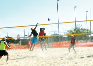Players braved the cold as they hit the sand in last weekends DTS/FABUPHARM Beach Volleyball Tournament
