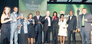 The new Windhoek Lager Ambassadors are, from the left, Viktoria Keding, Michael Amushelelo, Rachel Muinjo, Lischen Khachas, Helena Namene, Ingrid Muhenye and Johannes Nambala They are congratulated by the Deputy Minister of Trade and Industry, Tjekero Tweya (centre left), O&L Board Chairman Sven Thieme (centre right) and Wessie van der Westhuizen (far right), Managing Director of the Breweries.