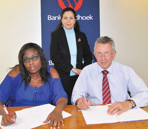 Signing the recognition agreement this week are from the left, Asnath Zamuee, General Secretary of the Namibia Financial Institutions Union (NAFINU), Elize Fahl, Executive Officer: Human Resources at Bank Windhoek and Christo de Vries, the bank's Managing Director.